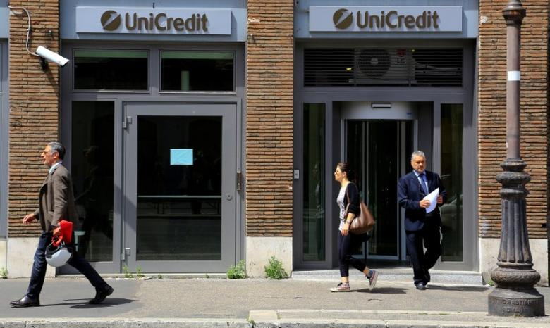 FILE PHOTO: People walk past a UniCredit bank in downtown Rome, May 10, 2016. REUTERS/Tony Gentile/File Photo