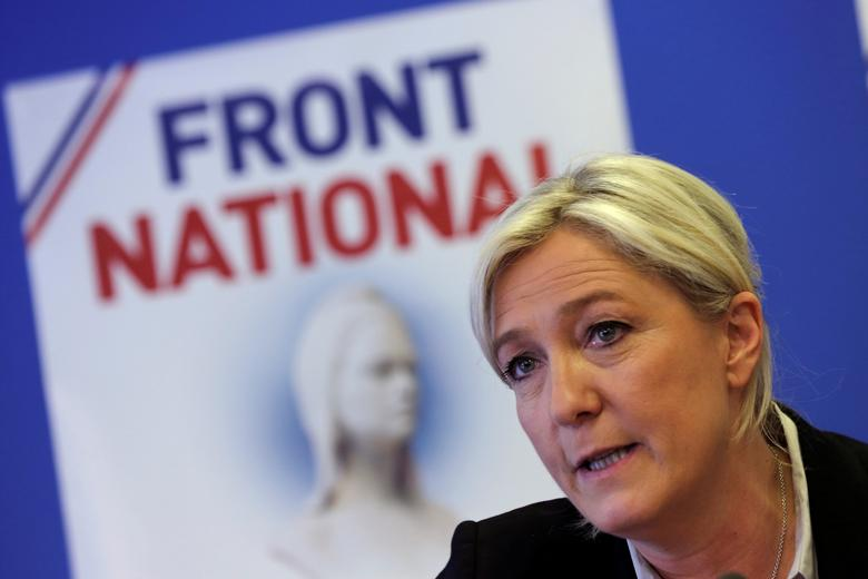 FILE PHOTO: Marine Le Pen, France's National Front political party head, attends a news conference at the party's headquarters in Nanterre, near Paris, France, May 27, 2014. REUTERS/Philippe Wojazer/File Photo