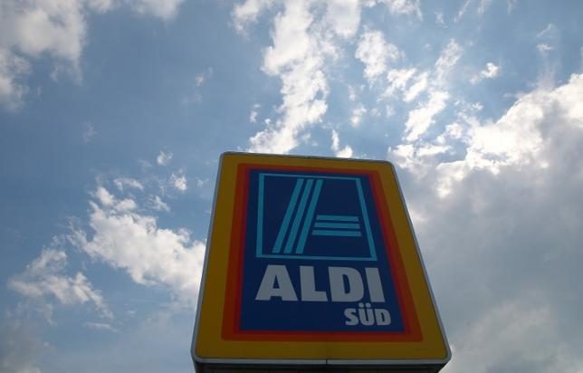 A sign directing shoppers to an ALDI Sued grocery store in Unterhaching, Germany May 18, 2017. REUTERS/Michael Dalder