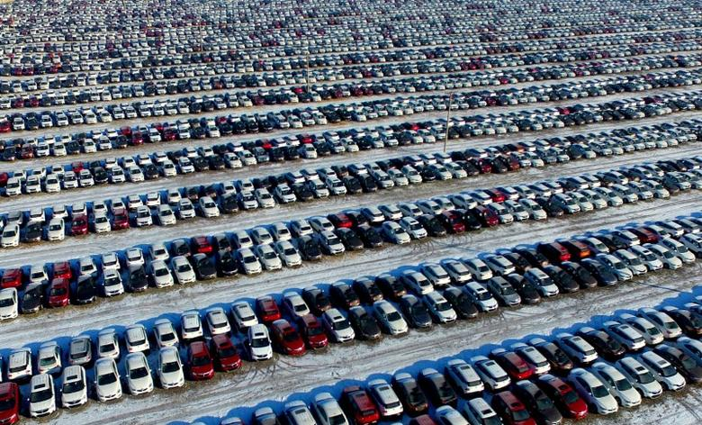 File Photo - New cars are seen at a parking lot in Shenyang, Liaoning province, China, January 16, 2017. REUTERS/Stringer