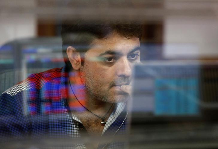 A broker reacts while trading at his computer terminal at a stock brokerage firm in Mumbai, India, February 26, 2016. REUTERS/Shailesh Andrade/Files