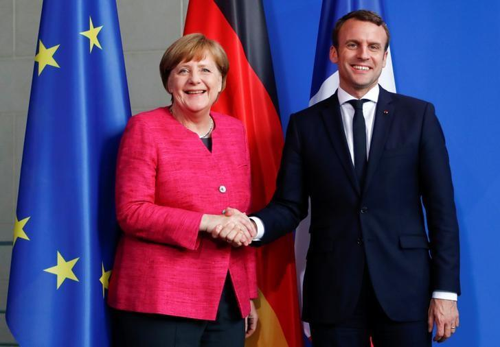 German Chancellor Angela Merkel and French President Emmanuel Macron shake hands after a news conference at the Chancellery in Berlin, Germany, May 15, 2017.   REUTERS/Fabrizio Bensch