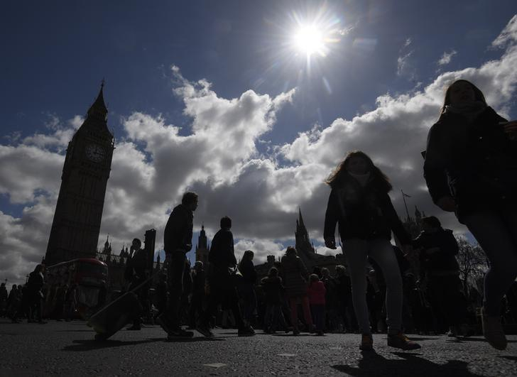 Pedestrians walk past the Houses of Parliament, in central London, Britain April 18, 2017.   REUTERS/Toby Melville
