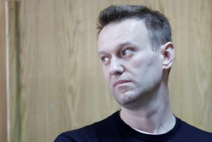 FILE PHOTO: Russian opposition leader Alexei Navalny attends a hearing after being detained at the protest against corruption and demanding the resignation of Prime Minister Dmitry Medvedev, at the Tverskoi court in Moscow, Russia March 27, 2017. REUTERS/Tatyana Makeyeva/File Photo
