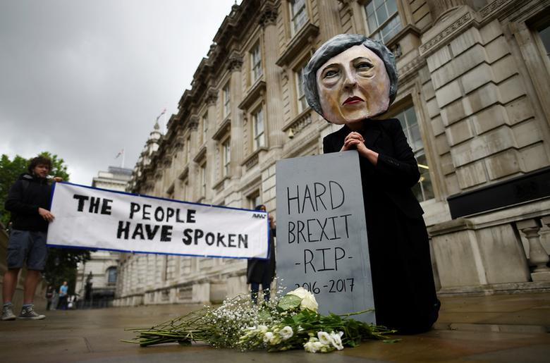 Protestor wearing a Theresa May mask is seen the day after Britain's election in London. REUTERS/Clodagh Kilcoyne