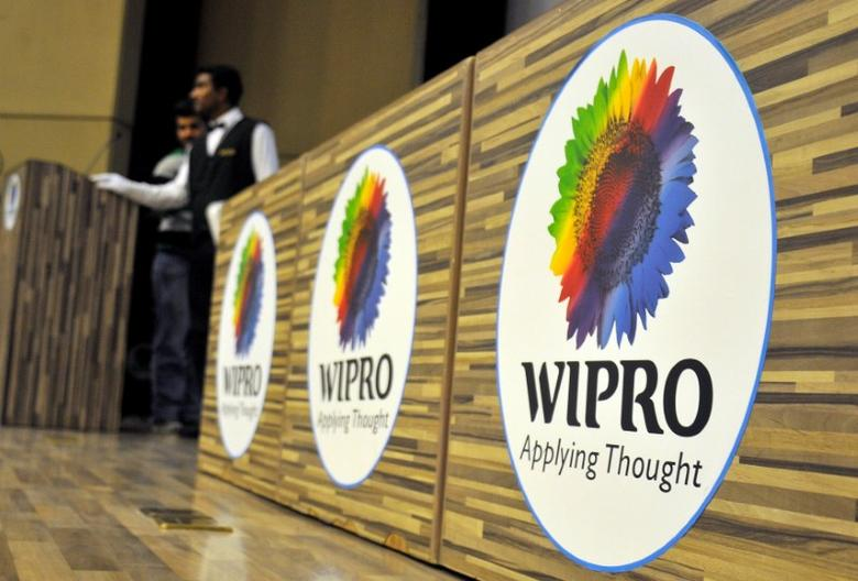 FILE PHOTO -  Stewards are seen behind desks with the logo of India's third-largest software services firm Wipro Ltd inside the company's headquarters in Bengaluru, India, October 21, 2016. REUTERS/Abhishek N. Chinnappa/File Photo