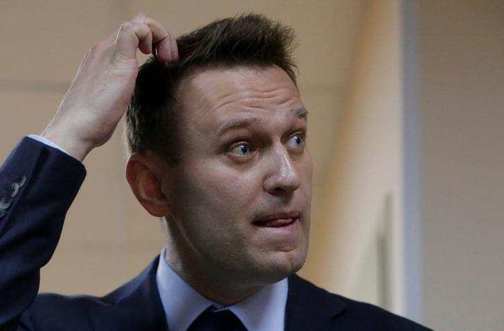 FILE PHOTO: Russian leading opposition figure Alexei Navalny reacts during a break in a hearing in the slander lawsuit filed against him by Russian businessman Alisher Usmanov, in a court in Moscow, Russia May 30, 2017. REUTERS/Sergei Karpukhin/File Photo