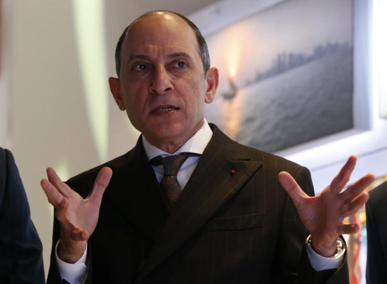 FILE PHOTO: Qatar Airways Chief Executive Akbar Al Baker gestures as he tours the exhibition stand of the company at the International Tourism Trade Fair (ITB) in Berlin, Germany, March 9, 2016.   REUTERS/Fabrizio Bensch