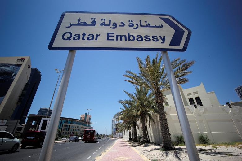 A sign indicating a route to Qatar embassy is seen in Manama, Bahrain, June 5, 2017. REUTERS/Hamad I Mohammed