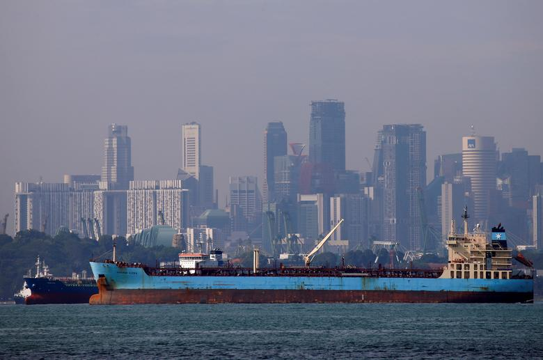 FILE PHOTO: Oil tankers pass the skyline of Singapore June 8, 2016. REUTERS/Edgar Su/File Photo