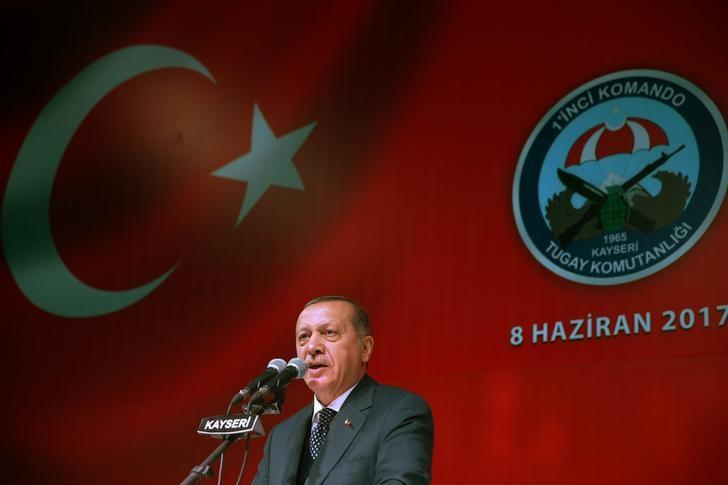 Turkish President Tayyip Erdogan makes a speech during a fast-breaking iftar dinner at the 1. Commando Brigade in Kayseri, Turkey, June 8, 2017. Kayhan Ozer/Presidential Palace/Handout via REUTERS