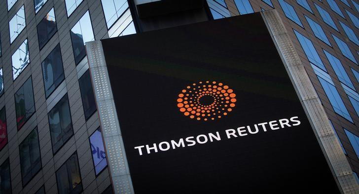 FILE PHOTO -  The Thomson Reuters logo is seen on the company building in Times Square, New York October 29, 2013.  REUTERS/Carlo Allegri/File Photo