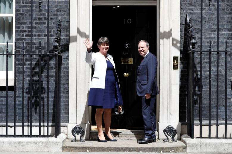 The leader of the Democratic Unionist Party (DUP), Arlene Foster, and the Deputy Leader Nigel Dodds, stand on the steps of 10 Downing Street before talks with Britain's Prime Minister Theresa May, in central London, Britain June 13, 2017.  REUTERS/Phil Noble