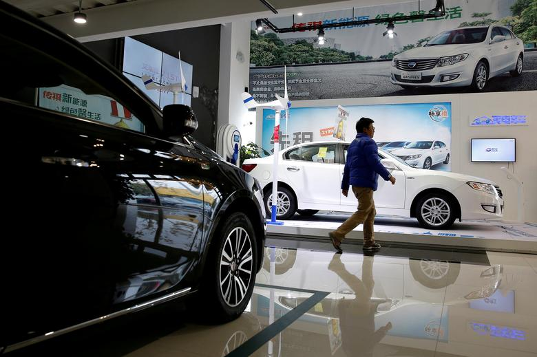 A man walks through an electric car dealership in Shanghai, China, January 11, 2017. REUTERS/Aly Song/File Photo