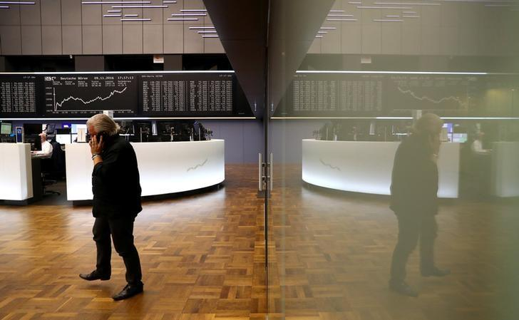 A trader at the Frankfurt stock exchange reacts on late afternoon trading results in Frankfurt, Germany, November 9, 2016. REUTERS/Kai Pfaffenbach/ Files