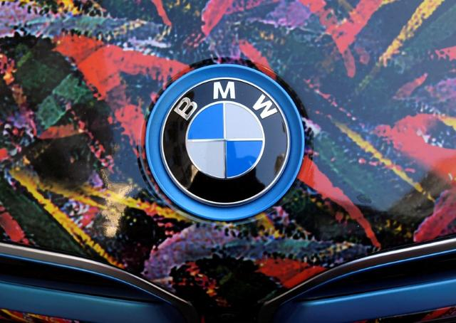 The BMW logo is seen on the bonnet of a colour wrapped vehicle in London, Britain September 30, 2016. REUTERS/Toby Melville