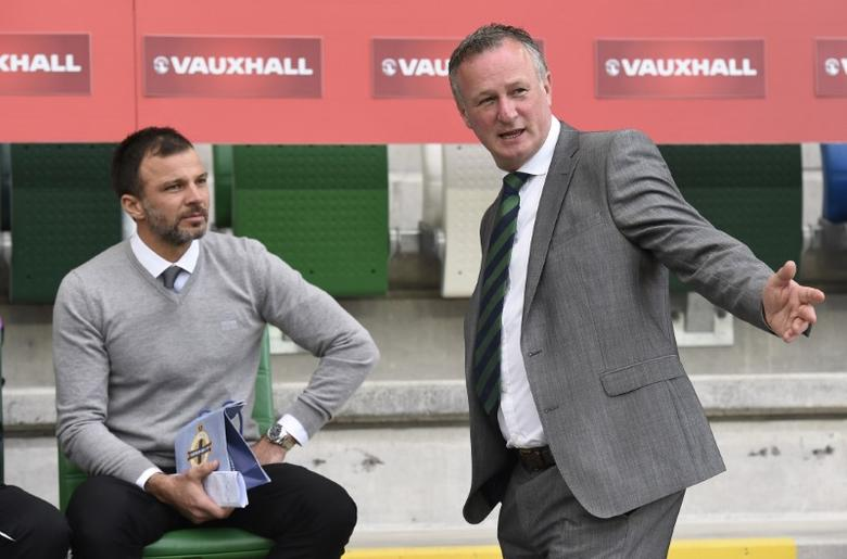 Britain Soccer Football - Northern Ireland v New Zealand - International Friendly - Windsor Park, Belfast, Northern Ireland - June 2, 2017 Northern Ireland manager Michael O'Neill  with New Zealand coach Anthony Hudson before the match  Reuters / Michael Cooper Livepic