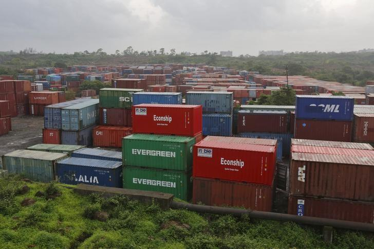 Cargo containers are seen stacked outside the container terminal of Jawaharlal Nehru Port Trust (JNPT) in Mumbai, July 15, 2015. REUTERS/Shailesh Andrade/Files