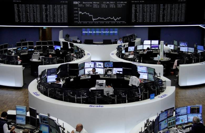 Traders work in front of the German share price index, DAX board, at the stock exchange in Frankfurt, Germany, June 12, 2017. REUTERS/Staff/Remote