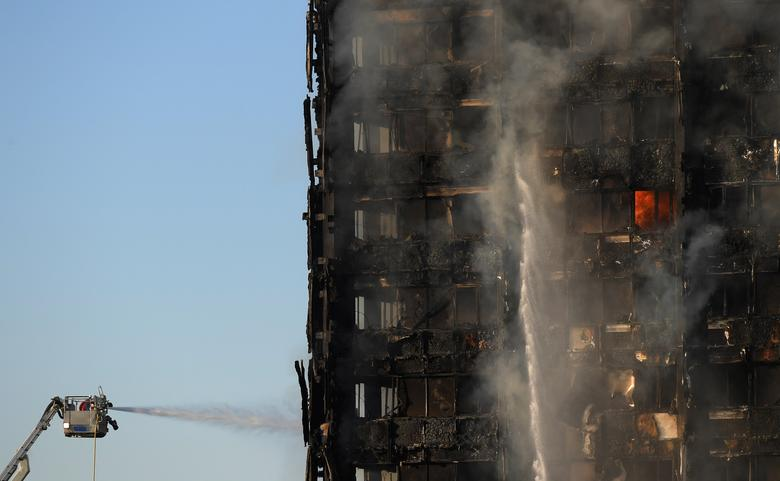 Firefighters tackle a serious fire in a tower block at Latimer Road in West London, Britain June 14, 2017. REUTERS/Toby Melville