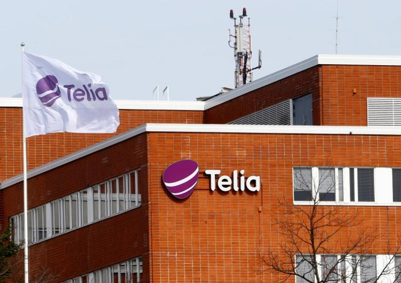 A flag flutters at the Telia telecommunication company headquarters in Helsinki, Finland, May 5, 2017. REUTERS/Ints Kalnins