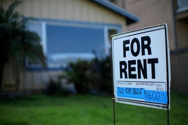 FILE PHOTO - A ''For Rent'' sign is posted outside a residential home in Carlsbad, California, U.S. on January 18, 2017.  REUTERS/Mike Blake/File Photo