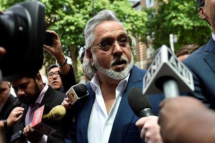 Force India co-owner, Vijay Mallya, talks outside Westminster Magistrates, in central London, Britain June 13, 2017.  REUTERS/Hannah McKay