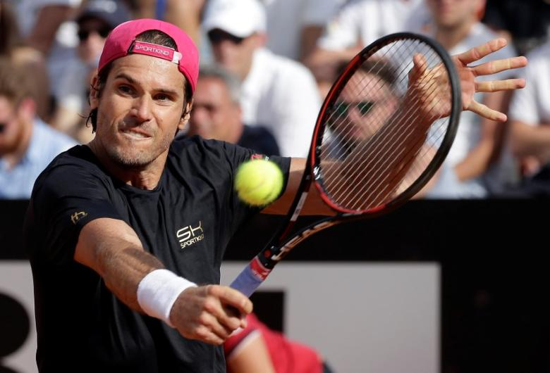 FILE PHOTO: Tennis - ATP - Rome Open - Milos Raonic of Canada v Tommy Haas of Germany - Rome, Italy- 17/5/17- Haas returns the ball. REUTERS/Max Rossi