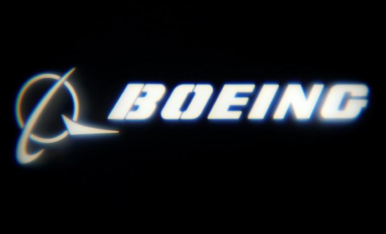 FILE PHOTO: The Boeing Company logo is projected on a wall at the ''What's Next?'' conference in Chicago, Illinois, U.S., October 4, 2016.    REUTERS/Jim Young