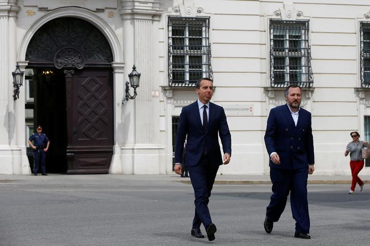 Austria's Chancellor Christian Kern (L), of the Social Democratic Party (SPOe), and his spokesperson Juergen Schwarz leave the chancellery in Vienna, Austria May 15, 2017. REUTERS/Leonhard Foeger