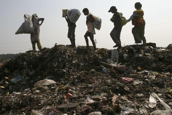 Children working as rag pickers search for scrap at a garbage dump in Siliguri November 14, 2008. REUTERS/Rupak De Chowdhuri/Files