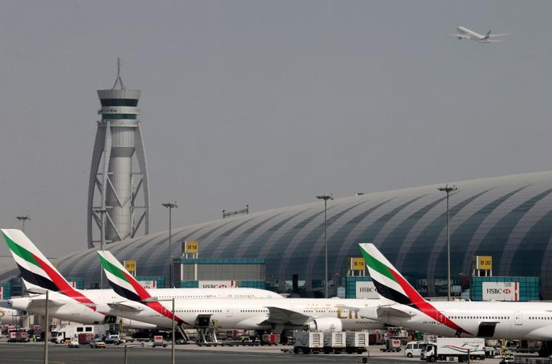 FILE PHOTO: FILE PHOTO: Emirates Airlines aircrafts are seen at Dubai International Airport, United Arab Emirates May 10, 2016. REUTERS/Ashraf Mohammad/File photo
