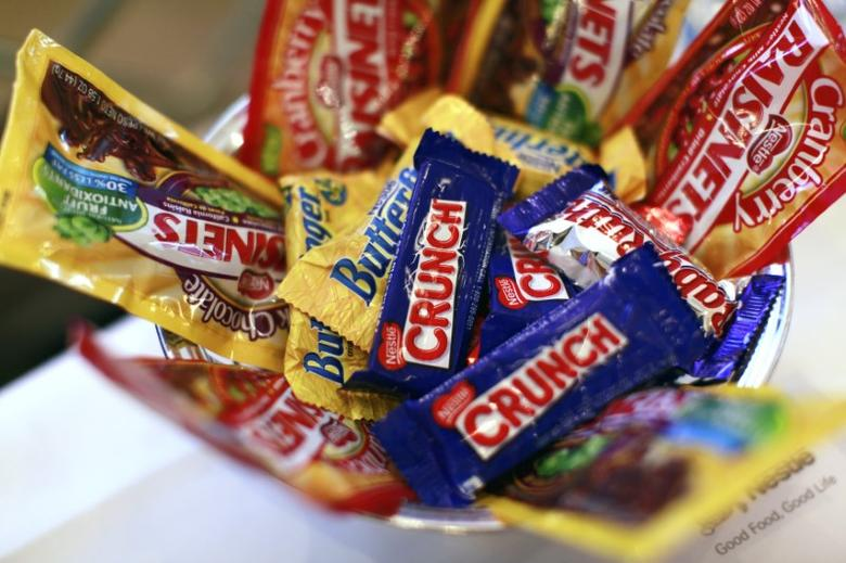 Nestle candy products are displayed the company's news conference in New York October 22, 2010.  REUTERS/Brendan McDermid