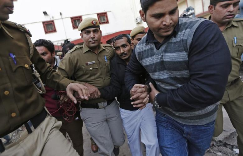 FILE PHOTO: Policemen escort driver Shiv Kumar Yadav (3rd R in black jacket) who is accused of a rape outside a court in New Delhi December 8, 2014.  REUTERS/Adnan Abidi