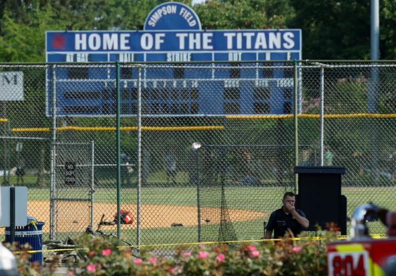 Police investigate a shooting scene after a gunman opened fire on Republican members of Congress during a baseball practice near Washington in Alexandria, Virginia, June 14, 2017. REUTERS/Joshua Roberts