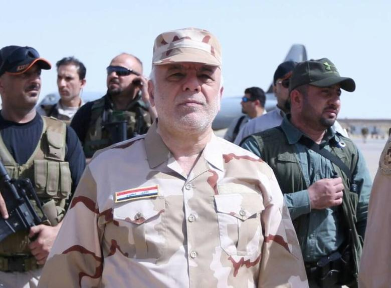 Iraqi Prime Minister Haider al-Abadi (C) walks during his visit to Mosul, Iraq May 29, 2017. Iraqi Prime Minister Office/Handout via REUTERS   ATTENTION EDITORS - THIS IMAGE WAS PROVIDED BY A THIRD PARTY. REUTERS IS UNABLE TO INDEPENDENTLY VERIFY THIS IMAGE. FOR EDITORIAL USE ONLY. NO RESALES. NO ARCHIVES.