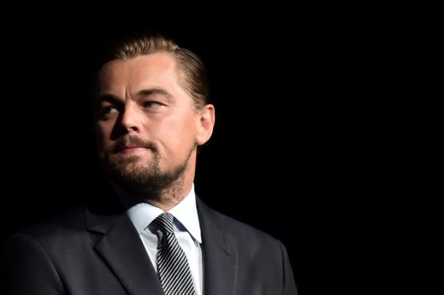 FILE PHOTO: U.S. actor Leonardo DiCaprio looks on prior to speaking on stage during the Paris premiere of the documentary film ''Before the Flood'' at the Theatre du Chatelet in Paris, France on October 17, 2016.    REUTERS/Christophe Archambault/Pool/File Photo     TPX IMAGES OF THE DAY