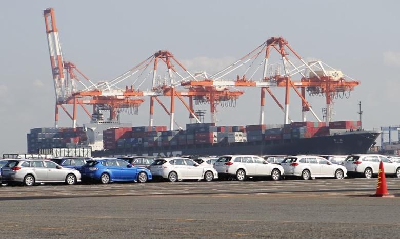 FILE PHOTO - Newly produced cars and a container ship are seen at an industrial port in Yokohama, south of Tokyo December 22, 2010. REUTERS/Toru Hanai
