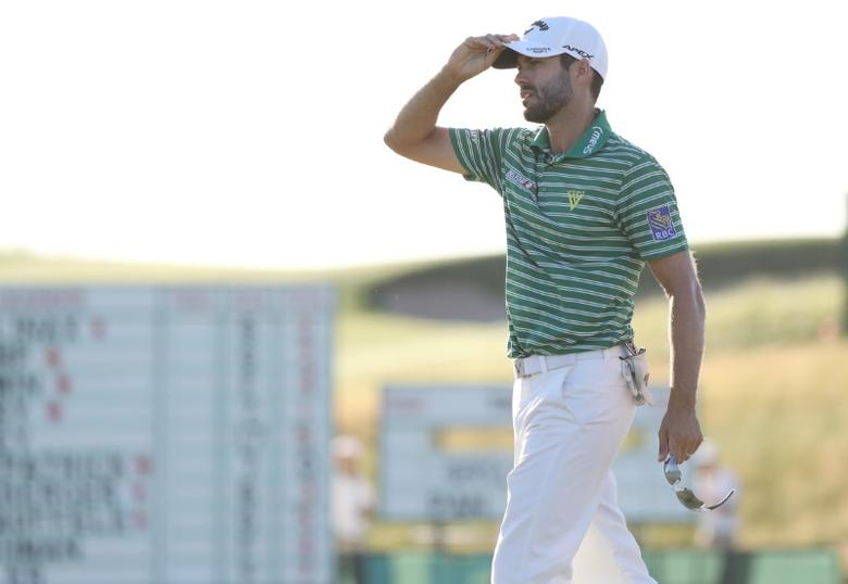 Jun 15, 2017; Erin, WI, USA; Adam Hadwin tips his cap after finishing on the 9th green during the first round of the U.S. Open golf tournament at Erin Hills.  Geoff Burke-USA TODAY Sports