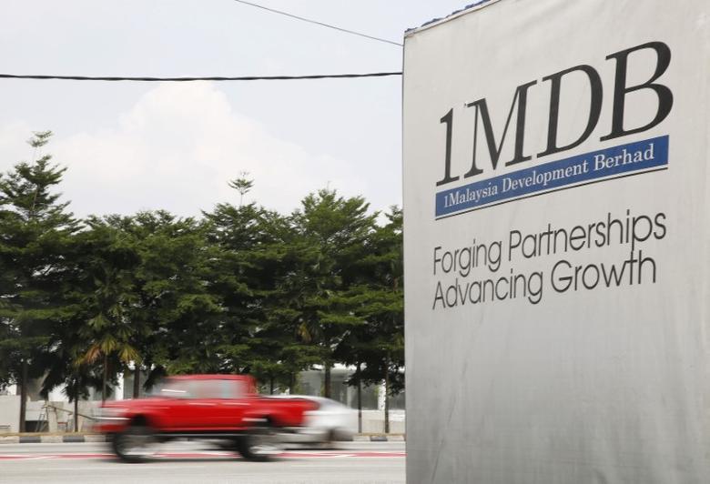 FILE PHOTO: Traffic passes a 1Malaysia Development Berhad (1MDB) billboard at the Tun Razak Exchange development in Kuala Lumpur, Malaysia, July 6, 2015. REUTERS/Olivia Harris/File Photo