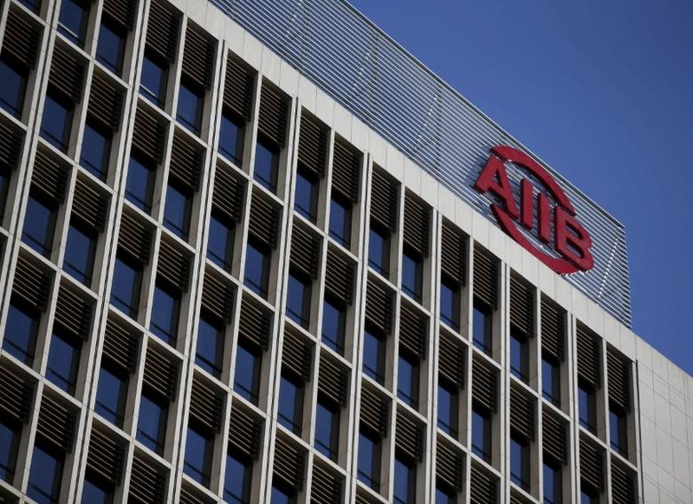 The logo of Asian Infrastructure Investment Bank (AIIB) is seen at its headquarter building in Beijing January 17, 2016. REUTERS/Kim Kyung-Hoon