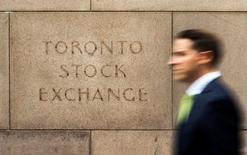 FILE PHOTO - A man walks past an old Toronto Stock Exchange (TSX) sign in Toronto, Ontario, Canada on June 23, 2014.  REUTERS/Mark Blinch/File Photo