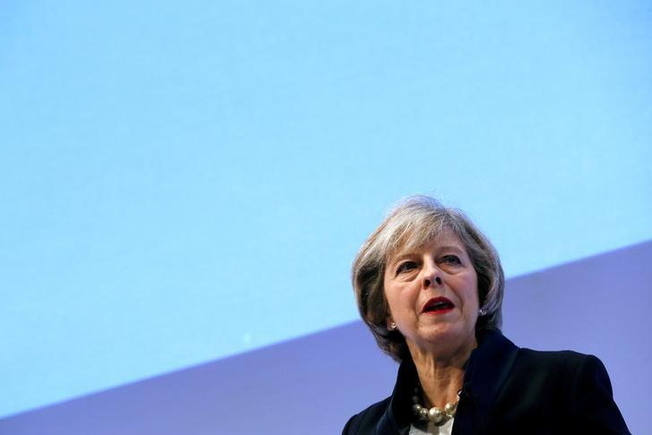 FILE PHOTO: Britain's Prime Minister Theresa May addresses the Confederation of British Industry's (CBI) annual conference in London, November 21, 2016. REUTERS/Stefan Wermuth/File Photo