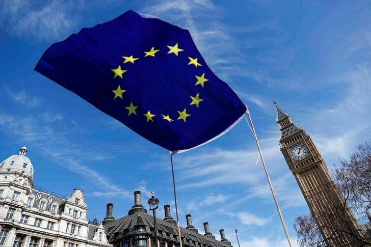 FILE PHOTO: An EU flag flies above Parliament Square during a Unite for Europe march, in London, Britain March 25, 2017.    REUTERS/Peter Nicholls/File Photo