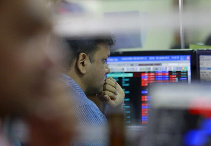 A broker reacts while trading at his computer terminal at a stock brokerage firm in Mumbai, India, June 29, 2015.  REUTERS/Danish Siddiqui/Files