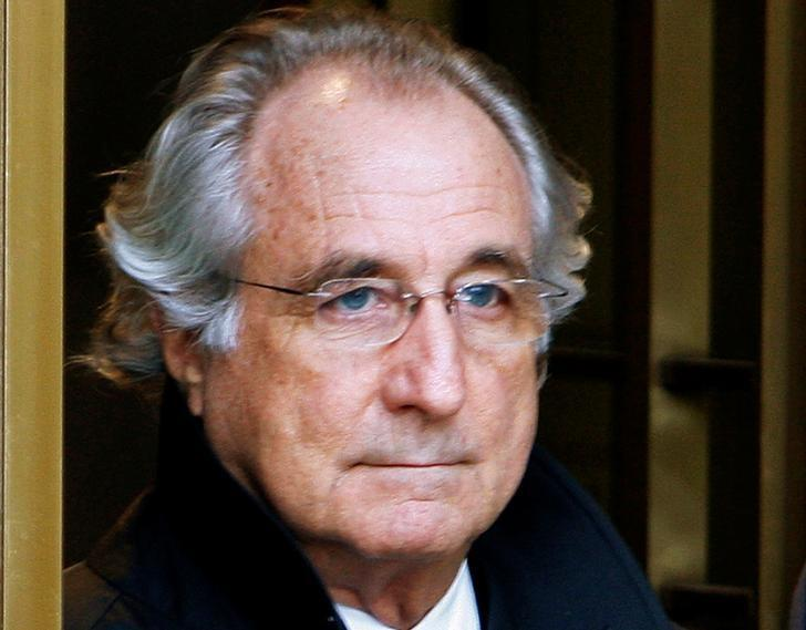 FILE PHOTO - Bernard Madoff exits the Manhattan federal court house in New York in this January 14, 2009 file photo.   REUTERS/Brendan McDermid/File Photo - RTX2YWS2