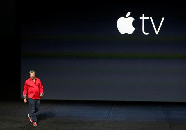 FILE PHOTO - Eddie Cue, Apple's senior vice president of Internet Software and Services, takes the stage to discuss Apple TV during an Apple media event in San Francisco, California, U.S. on September 9, 2015.   REUTERS/Beck Diefenbach/File Photo