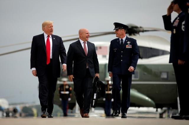 U.S. President Donald Trump walks toward Air Force One, accompanied by White House National Security Advisor H.R. McMaster (C) as they depart Joint Base Andrews in Maryland, U.S., June 16, 2017, before their departure to Miami, Florida. REUTERS/Carlos Barria