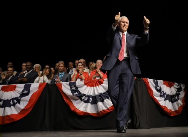U.S. Vice President Mike Pence takes the stage prior to a speech by U.S. President Donald Trump on US-Cuba relations at the Manuel Artime Theater in Miami, Florida, U.S., June 16, 2017. REUTERS/Carlos Barria