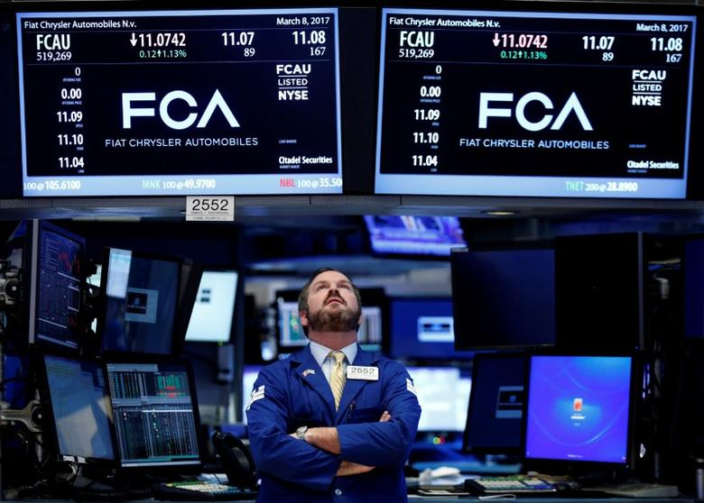 FILE PHOTO: A specialist trader works at the post where Fiat Chrysler Automobiles is traded on the floor of the New York Stock Exchange (NYSE) in New York, U.S., March 8, 2017. REUTERS/Brendan McDermid